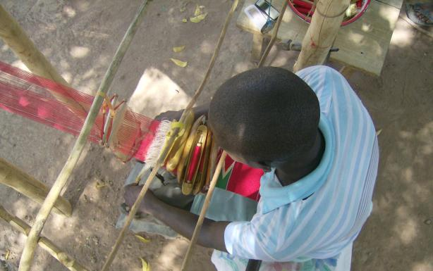 Man weaving kente in Eastern Region, Ghana