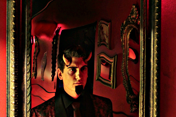 Elliott James' Satan looks into a mirror, darkly