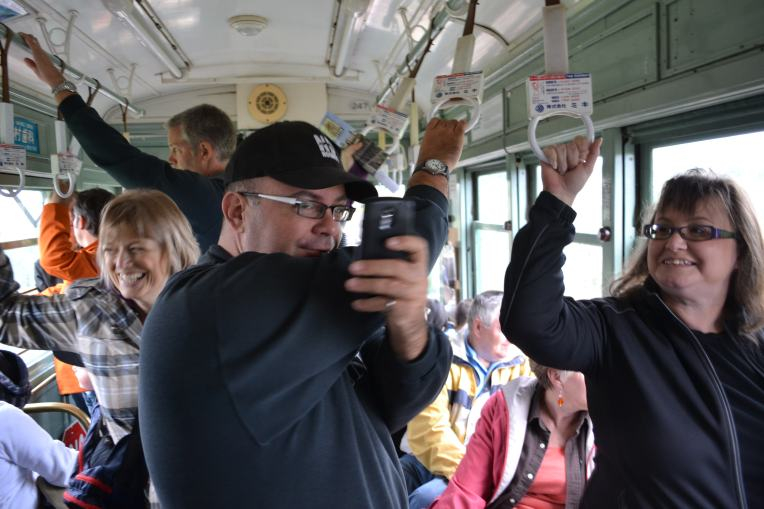 One of the Shareable Neighbourhood walkers takes a picture of me taking a picture of him on the streetcar