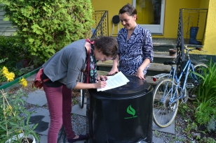 Rebecca delivers Amanda's rain barrel