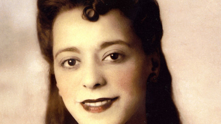 Viola Desmond smiles at the camera