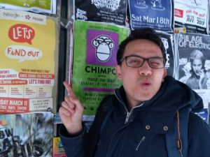Me pointing at one of the posters for the Let's Find Out live show on a billboard on Jasper Ave.
