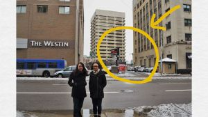 Rebecca and Barbara stand across the street from the site where the Liberator was published