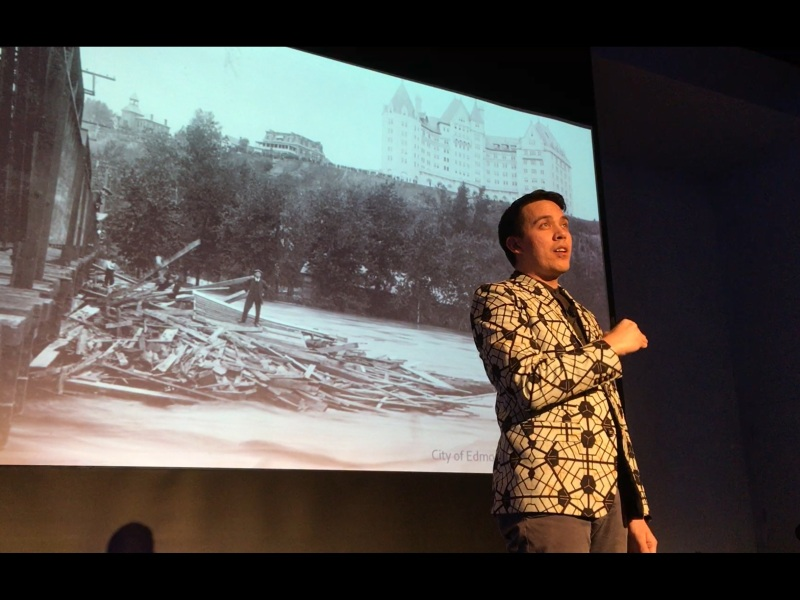 Chris speaking in front of a slide of the 1915 flood